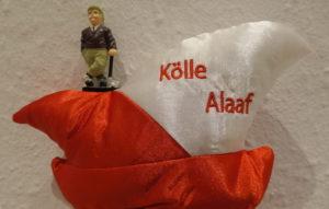 Bild zeigt Karnevalsmütze mit kleiner Golffigur und dem Schriftzug KÖLLE ALAAF